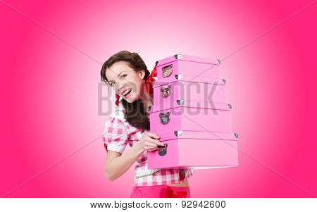 Young woman with storage boxes on white