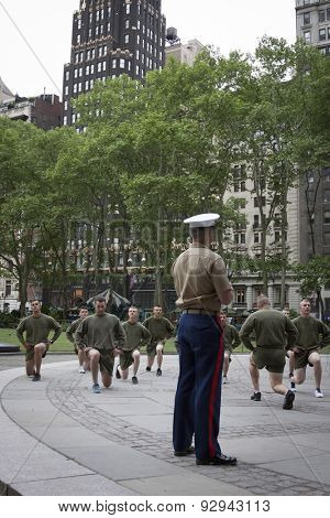 NEW YORK - MAY 21 2015: A group of US Marines doing lunges during an early morning boot camp exercise in Bryant Park at Marine Day during Fleet Week NY 2015.