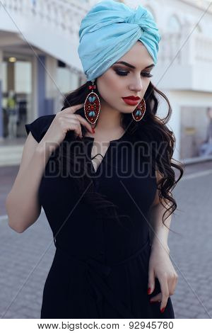Sensual Woman  Wearing Elegant Black Dress And Silk Turban
