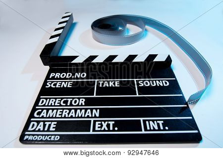 Closeup Of A Movie Clapper And Video Film Movie On A Light Background