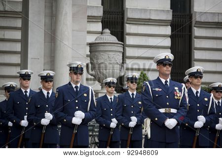 NEW YORK - MAY 21 2015: The US Coast Guard Ceremonial Honor Guard Silent Drill Team perform next to the New York Public Library in Bryant Park during Fleet Week NY 2015.