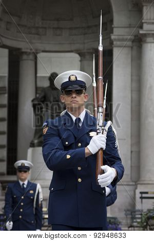 NEW YORK - MAY 21 2015: A member of the US Coast Guard Ceremonial Honor Guard Silent Drill Team performing next to the New York Public Library in Bryant Park during Fleet Week NY 2015.