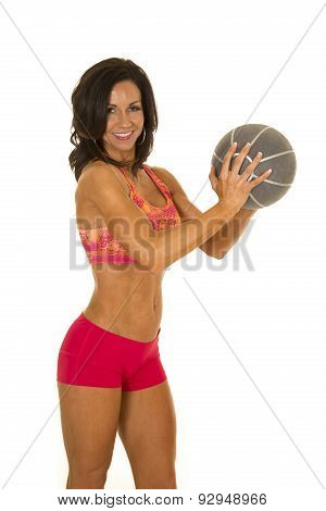 Woman In Pink Sports Outfit Medicine Ball Hold