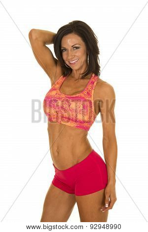 Woman In Pink Sports Outfit Stand Hand Behind Head