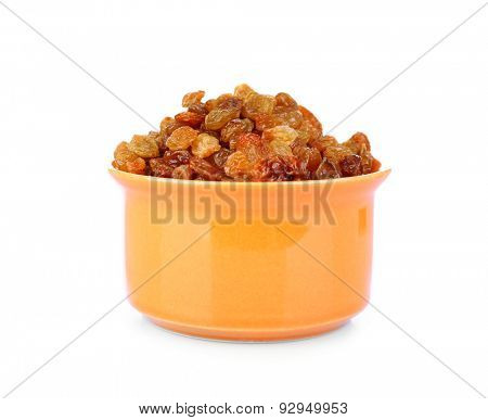 Raisins in bowl isolated on white