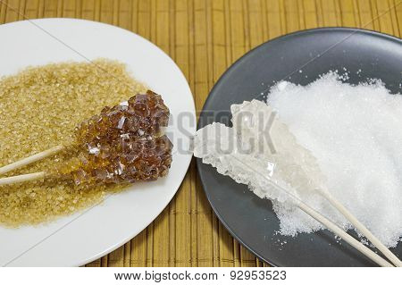 Two Sugar Sticks Containg White And Brown Sugar