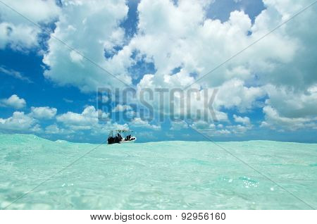 A Dive Boat and a cloudy sky In Los Roques Archipelago, Venezuela.