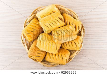 Small Strudels In Wicker Basket On Table