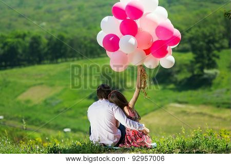 Sweet lovers with pink balloons