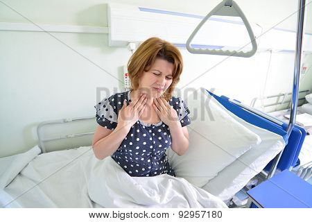 Female Patient With Angina On  Bed In Hospital Ward