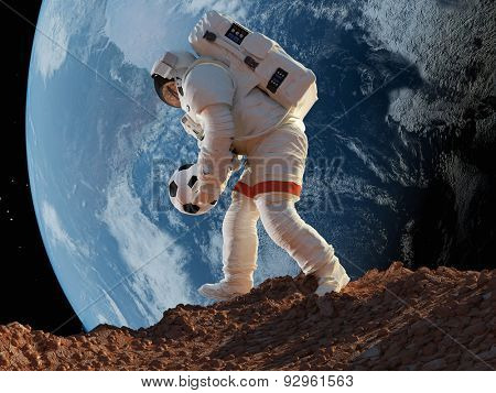 Astronaut with Ball in hand on the background of the Earth..