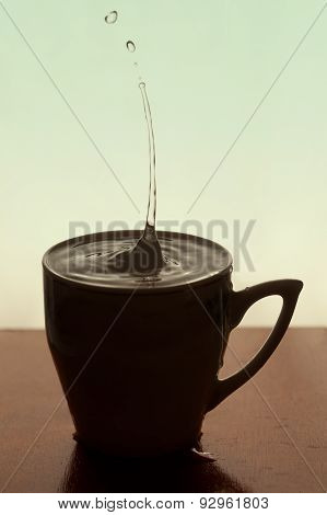 Water Drops In Cup Of Coffee