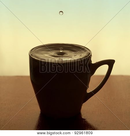 Water Drops, Splashing In Cup Of Tea, Coffee. Retro Colors And Sepia Effect. Soft Focus, Macro View