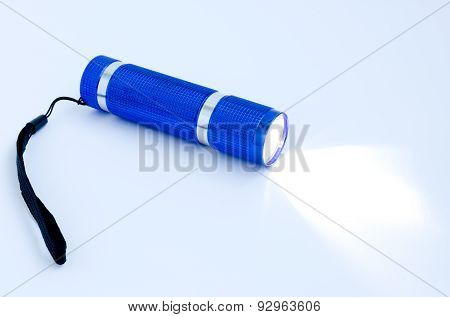 Glowing Blue Flashlight On A White Background