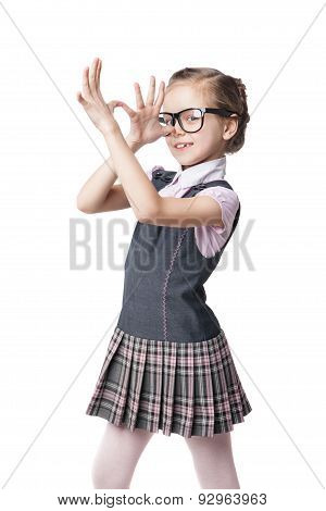 Funny little girl in glasses makes faces