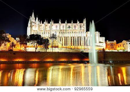 The Fountain Near Cathedral Of Santa Maria Of Palma In Palma De Mallorca, Spain