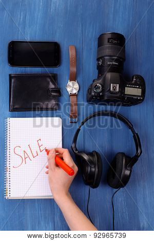 Sale unwanted stuff on wooden background top view