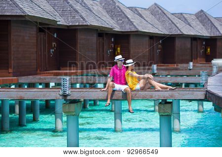 Couple on beach jetty at tropical island