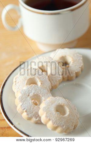 Italian Canestrelli Biscuits On The Saucer Near A Cup Of Black Tea