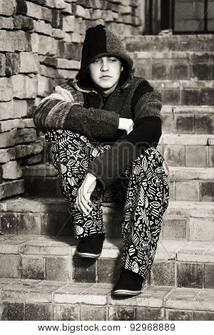 Young fashion hippie man sitting on the steps
