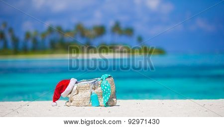 Beach accessories with Santa Hat on white tropical beach