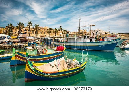 Marsaxlokk, Malta - 24 May 2015: fishing boats near fishing village of Marsaxlokk (Marsascala) in Malta