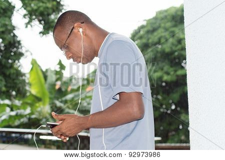 Young man communicating with an earphone
