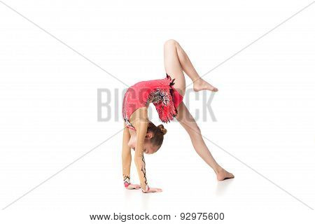 pretty little girl doing gymnastics over white background