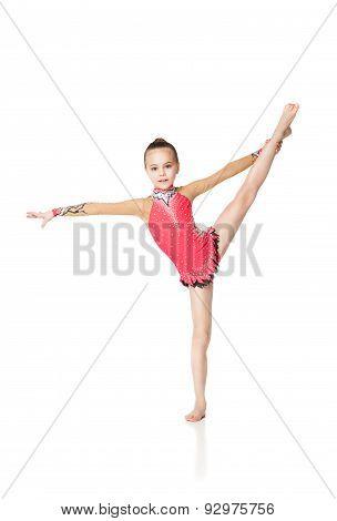 pretty little girl doing gymnastics over white background