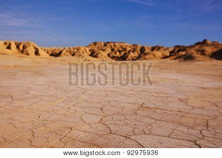cracked earth at Bardenas Reales desert Navarra Spain