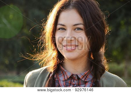 Beautiful Cheerful Sunny Young Girl With Red Plaits