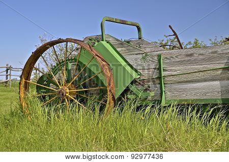 Old steel wheeled wood box manure spreader