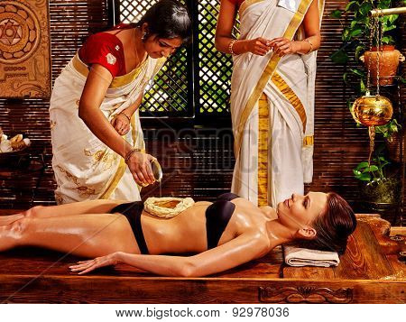 Young woman having dough stomach spa treatment.