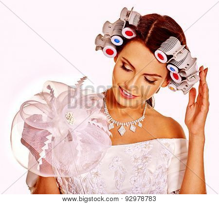Woman with hair curlers on head wear in wedding dress on isolated.