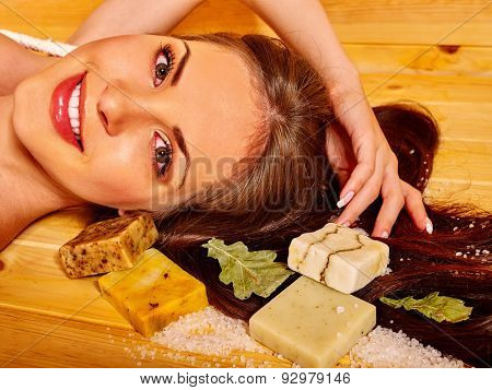 Portrait of young woman in sauna with soap. Healthy lifestyle.