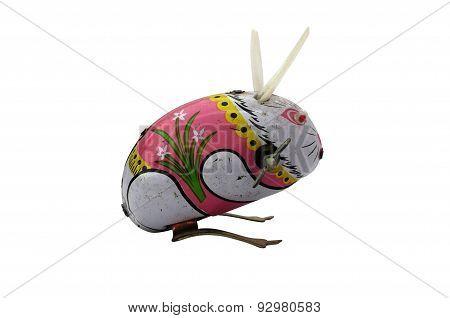 Wind-up vintage toy rabbit isolated on white background