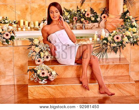 Woman relaxing in water spa with a lot of flower.