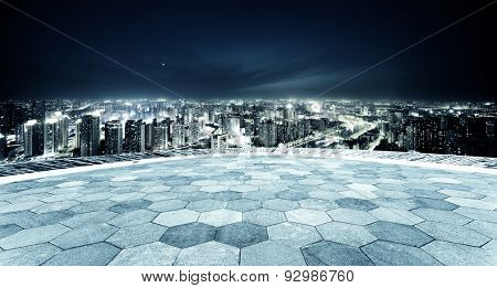 Empty footpath and panoramic modern skyline at night