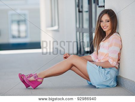 Young smiling woman portrait outdoors in the city.