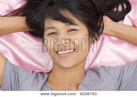 Beautiful Woman On Pink Silk