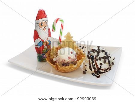 Ice cream in wafer cone, bowl with christmas decoration