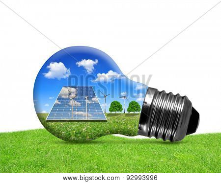 Solar panels and wind turbines in light bulb on white background. Green energy concept.