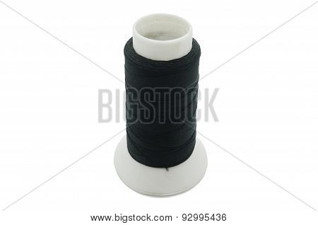 Black thread on few bobbin, spool