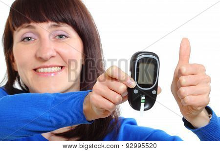 Smiling Woman With Glucose Meter Showing Thumbs Up