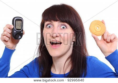 Surprised Woman Holding Glucose Meter And Cake