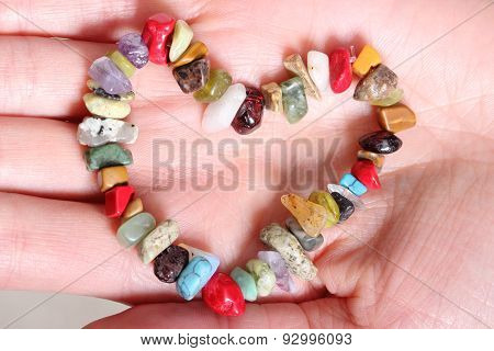 Heart Shaped Colorful Bracelet On Hand Of Woman