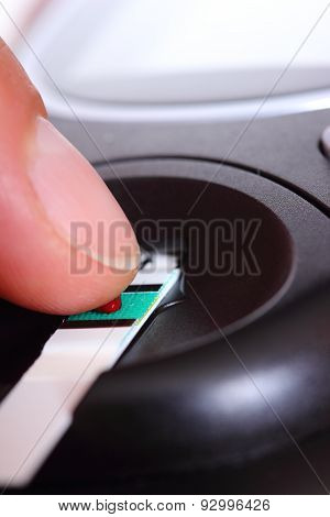 Closeup Of Finger With Blood And Glucose Meter