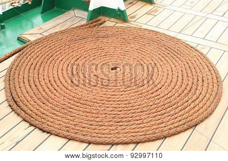 Thick Rope Wrapped In Spiral Lying On Deck Of Ship