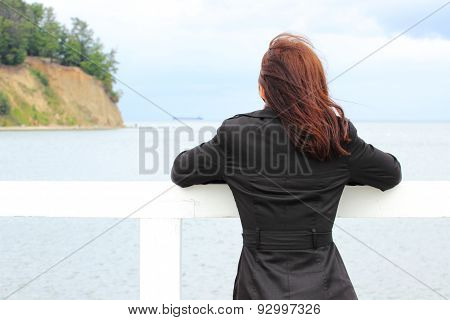 Woman On The Beach Looks At Sea, Summer Time
