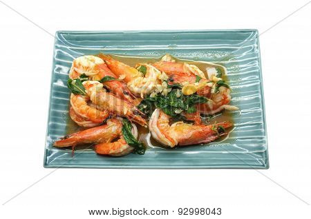 Shrimps fried with fresh herbs in dish